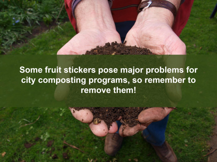 Picture of compost with warning that some fruit stickers cause problems for city composters