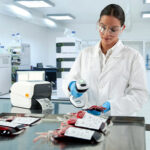 woman using handheld scanner in lab