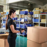 Woman in warehouse using handheld RFID reader