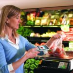 woman scanning product in grocery store