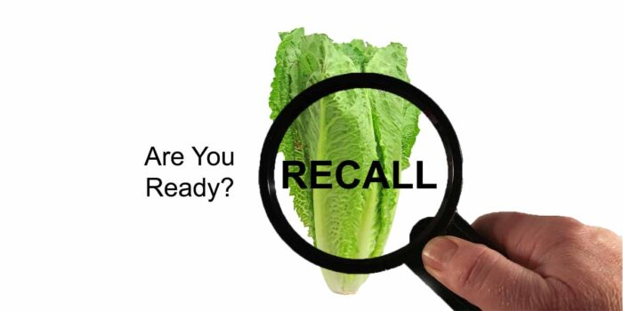 magnifying glass over lettuce with word recall